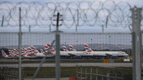 BA planes seen behind barbed wire fence