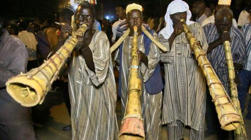 Sudanese protesters blowing traditional horns take to the streets in the capital Khartoum during a demonstration demanding the dissolution of the transitional government - 18 October 2021
