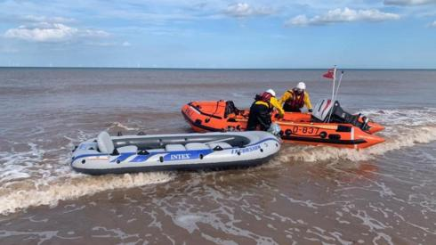 Dinghy being brought to shore