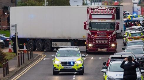 British police drive the lorry container where 39 people were found dead. Photo: 23 October 2019