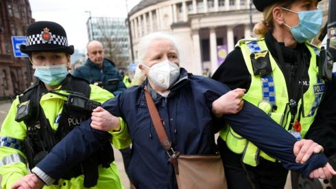 Protester arrested by two police women