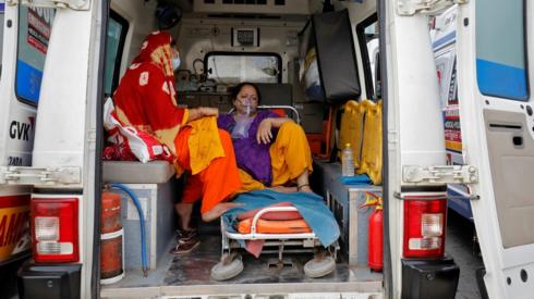 Patient with breathing apparatus in ambulance in Ahmedabad, India (20 April)
