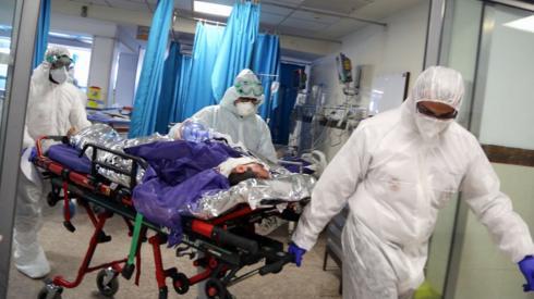Ambulance staff bring patient into a hospital in Tehran