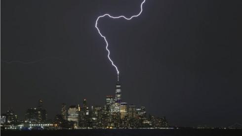 A lightning bolt strikes One World Trade Center in New York City.