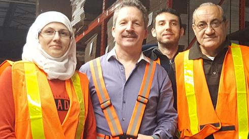 Jim Estill with some Syrian refugees who now work for Danby