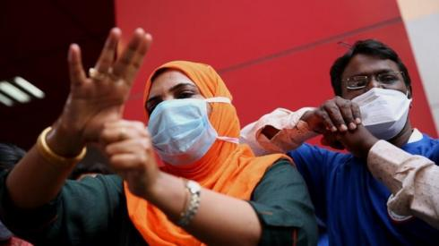 Medical officials in India show to the public how to properly wash their hands using gel sanitisers. File photo
