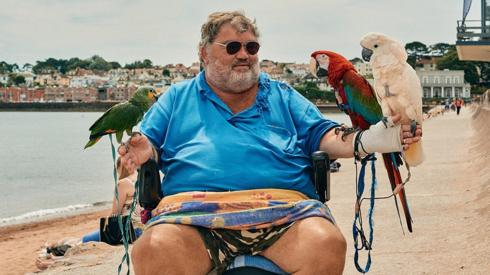 A local man takes his parrots out for a ride along Paignton Sea front