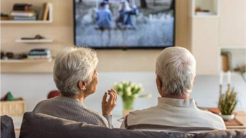 Elderly couple watching TV