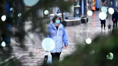 Woman in mask in Stirling