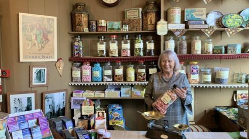 Elizabeth Lihou at the shop till.
