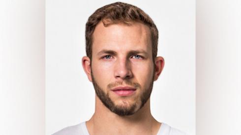 A headshot of Joe Watts