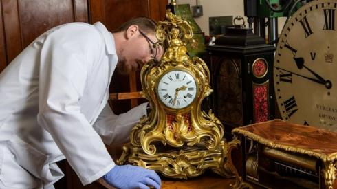 Fjodor working on a gold clock in his workshop
