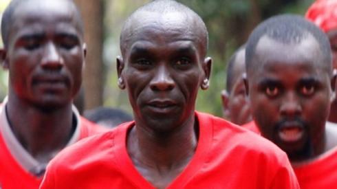 Eliud Kipchoge, the marathon world record holder, runs along athletic enthusiasts at the Karura forest in Nairobi, Kenya November 16, 2019