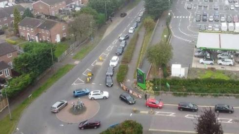 Motorists waiting to get into a filling station in Luton