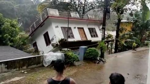 A house fell into an overflowing river on Sunday
