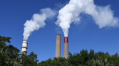 Billowing smokestacks are seen at Tampa Electric Big Bend power station, Florida