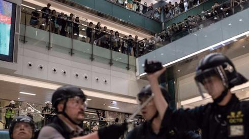 Riot police chased protesters into a shopping mall.