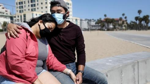 A couple in California wear face masks