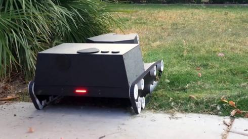 A robot, called Yardroid, mowing grass