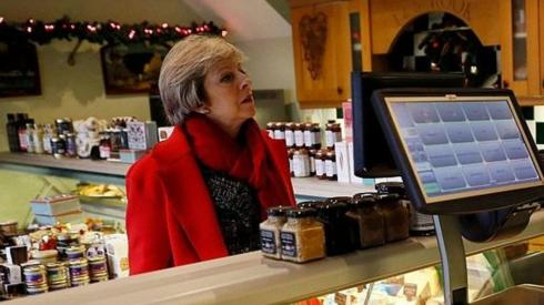 Theresa May and local butcher