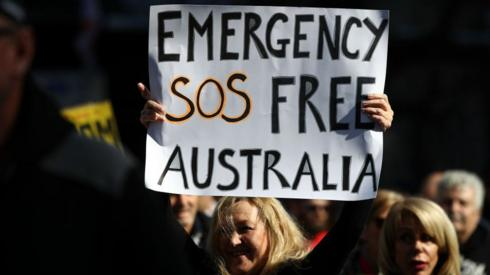 Image shows a protester in Sydney