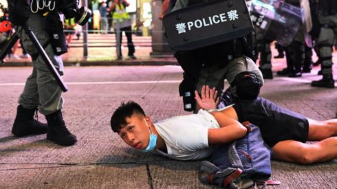 Police officers detain protesters during a rally against a new national security law on the 23rd anniversary of the establishment of the Hong Kong Special Administrative Region in Hong Kong, China, 01 July 2020