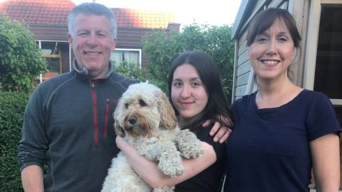 Parents with daughter and dog