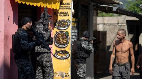 Civil Police officers take part in an operation against alleged drug traffickers at the Jacarezinho favela in Rio de Janeiro