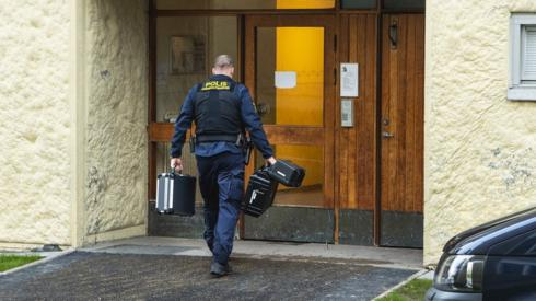 Police outside the apartment building in Haninge, 1 December
