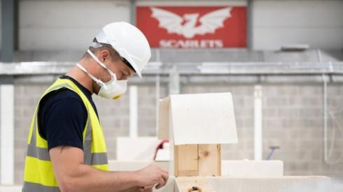 A builder helping to convert Parc Y Scarlets into a makeshift hospital
