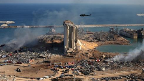 A general view shows the damaged grain silos of Beirut's harbour and its surroundings