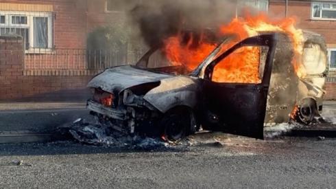 The burning van