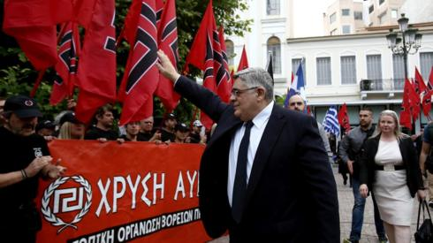 Golden Dawn leader Nikolaos Michaloliakos salutes party supporters in 2017 (file pic)