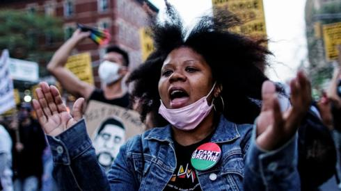 A woman reacts while marching with others after the verdict in the trial of former Minneapolis police officer Derek Chauvin, found guilty of the death of George Floyd, in New York City, New York, U.S., April 20, 2021.