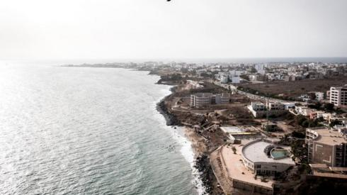 People swimming at the popular Mammelles beaches, in front of construction sites in Dakar, on June 27, 2020