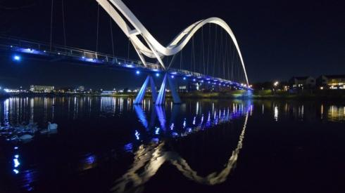 A bridge reflected in water