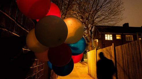 Balloons in an alleyway