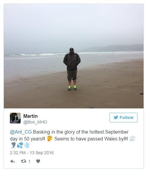 @Boo_MHO on Twitter: Basking in the glory of the hottest September day in 50 years! Seems to have passed Wales by! Photo: A cold man on a windswept beach.