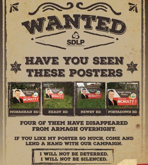 Justin's McNulty's poster, which reads: 'Wanted - have you seen thes eposters?'