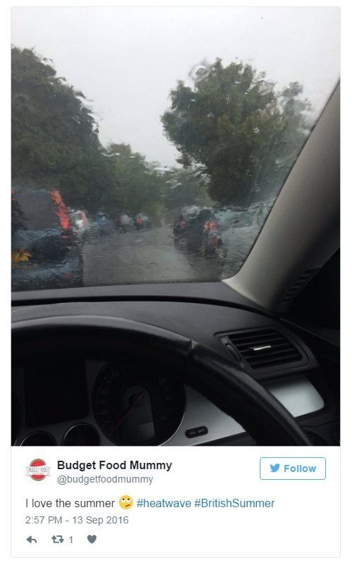 @budgetfoodmummy on Twitter: I love the summer. Hashtag: Heatwave. Hashtag: British Summer. Photo: Rain over a queue of cars in Redruth, Cornwall.
