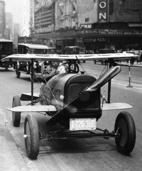 1924 flying car driving through Times Square, New York