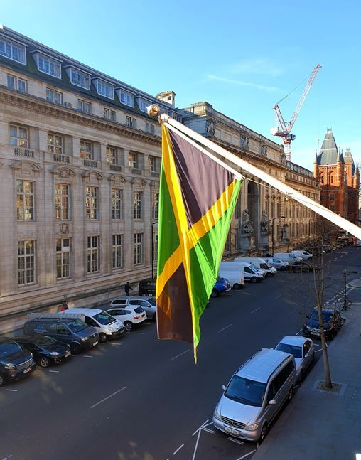 Image of the Jamaican flag outside the Jamaican High Commission