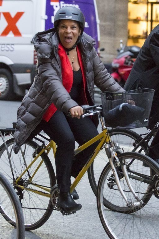 Ms Taubira on a yellow bicycle