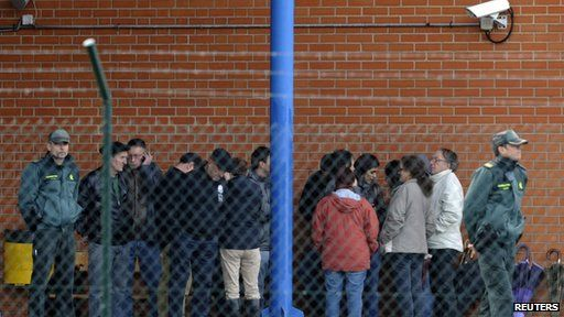 Family members and supporters of Basque separatist militant Ines del Rio wait outside a prison in Teixeiro