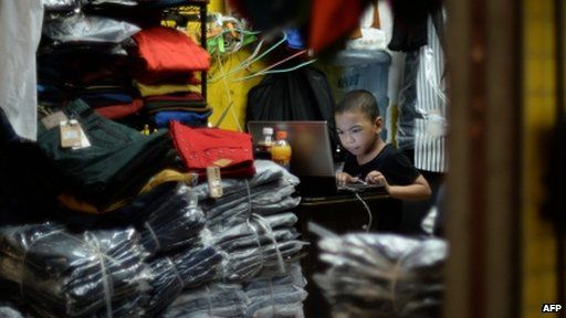 Chinese boy using computer