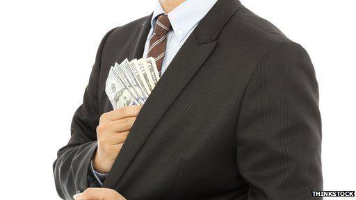 Man pocketing money