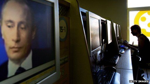 President Putin on TV at internet cafe