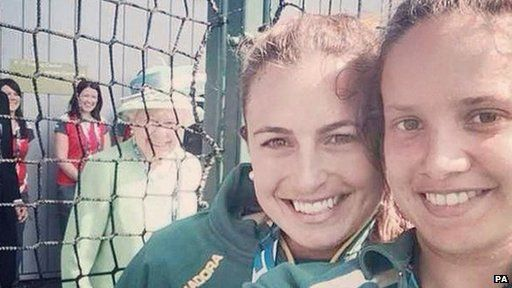 Queen photo bombs hockey players