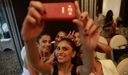 Indian women take selfie with a smartphone