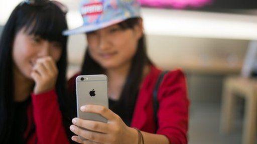 ladies holding iPhone